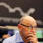 Stocks around the world fell after China revealed worst growth since t...